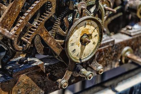 broken unity: old clockwork large clock with damaged dial