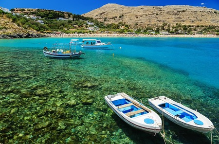 view of coast with boats in Lindos bay, Greece 版權商用圖片