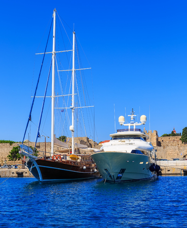 middle ages boat: Luxury Yacht docked at Rhodes Port,Greece, sunny Stock Photo
