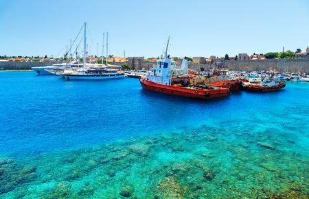 Boats in Mandraki Harbor. Rhodes Town, Rhodes, Greece Stock Photo