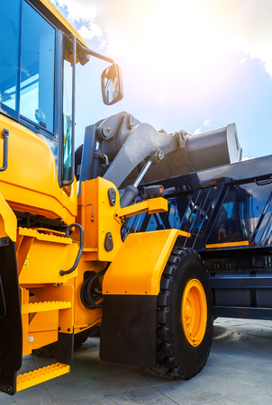 new construction: excavator cabin and bucket. construction equipment net new