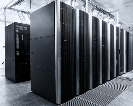 electricity providers: room with rows of modern supercomputers in the data center Stock Photo