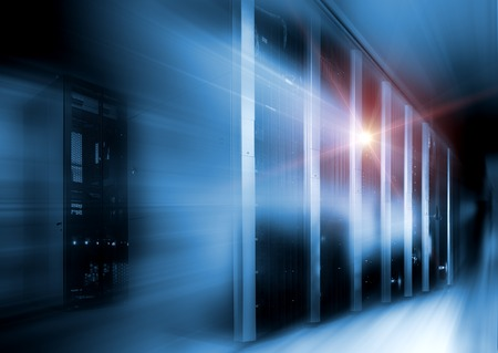 server room in dark, with bright colored lights motion Stock Photo