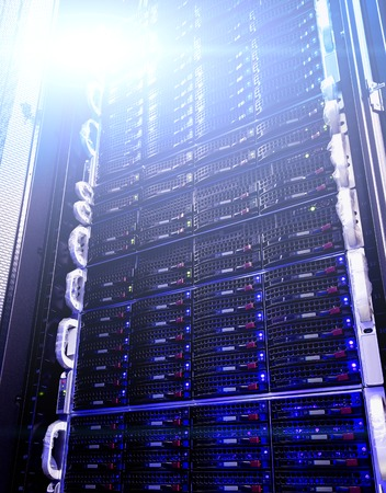 webserver: Array disk storage in the data center with depth of field in cool tone
