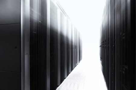 mainframe: server room with modern mainframe equipment in the data center. Black and white