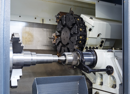 sharpening process: Rotating head with drilling machine bits and tools in high precision mechanics plant at CNC lathe in workshop