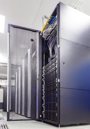 electricity providers: rackserver hardware with an open door in data center