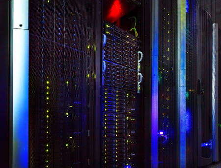 datacentre: fantastic view of the mainframe in data center rows