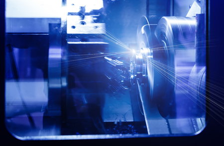 Rotating brilliant part of automated lathe for machining of metal parts