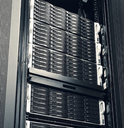 diskdrive: set of black hard drives in storage system in the data center Stock Photo