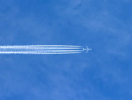 jetplane: Airplane with contrails in a clear blue sky, Cruising altitude