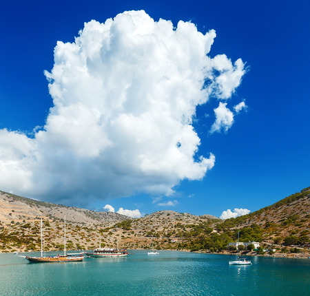 Boats in the harbor of Panormitis. Symi island, Greece. Stock Photo