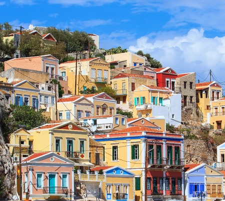 dodecanese: Traditional greek colorful houses in the Symi island. Dodecanese, Greece. Stock Photo