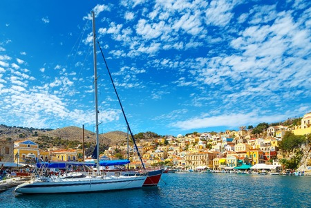 yacht and houses on symi island, Greece Stock Photo