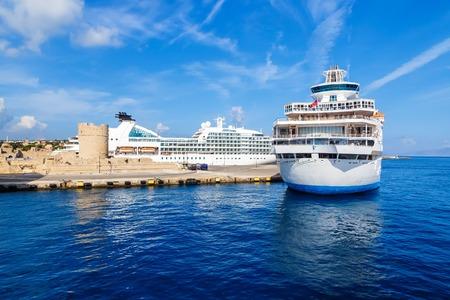 Passenger cruise ship. Large white passenger ship waiting in Rhodes Island port Stock Photo