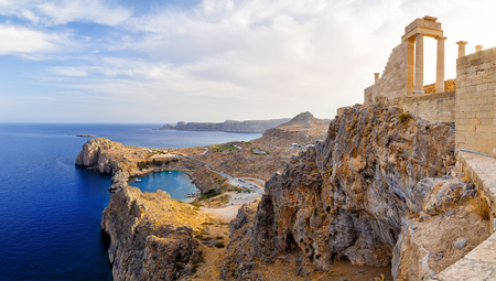 doric: Greece. Rhodes. Acropolis of Lindos. Doric columns of the ancient Temple of Athena Lindia the IV century BC and the bay of St. Paul Stock Photo