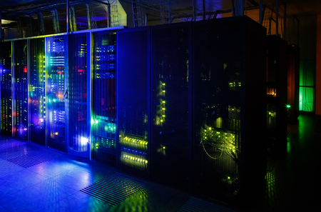 server room in dark, with bright colored lights