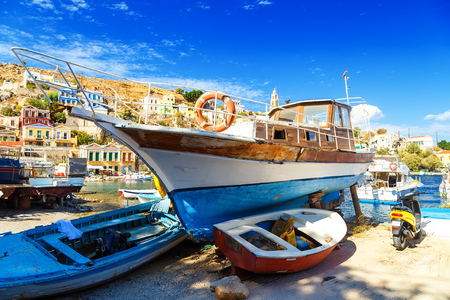 old ship: wooden boat on seashore, old ship on stocks, Fisher boat on the sea, old wooden boat on beach, old wooden boat in greece, Sailing boats in traditional shipyard in Greece