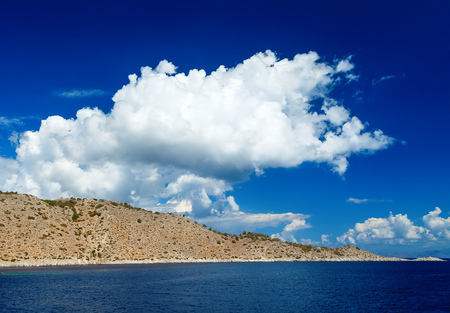 ancient atlantis: Blue sky and sea landscape with mountains white clouds