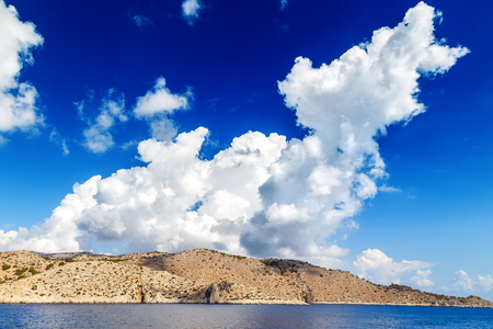 ancient atlantis: Blue sky and sea landscape with mountains clouds