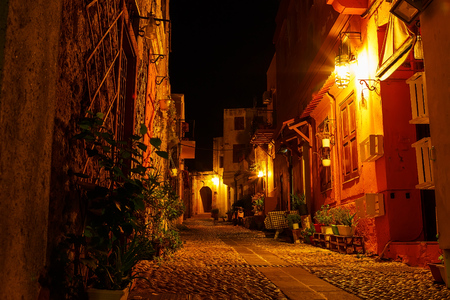 illuminating: streets of the night city of Rhodes, the old part of the city. Stock Photo
