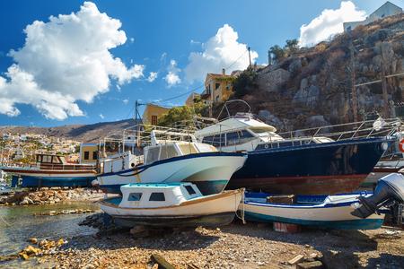 fishing boats on the stocks on the shore. Symi island Greece, Aegean sea Stock Photo