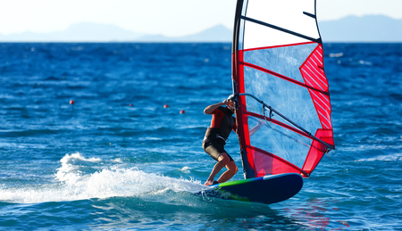 sailboard: windsurfer close-up on the crest of a wave rotates Stock Photo