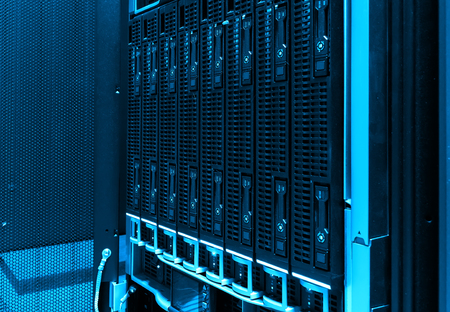 close-up of hard drives in modern data center. blue tone Stock Photo