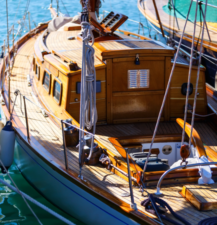 beautiful wooden sailboat docked in port close up. Blur