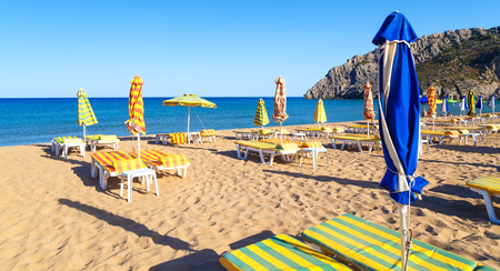tsampika beach with umbrellas and sunbeds, night deserted, Rhodes, Greece Stock Photo