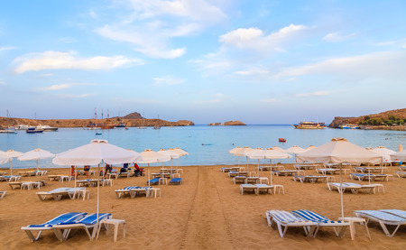 evening view at sunset on stunning beach at Lindos on the Greek Island of Rhodes