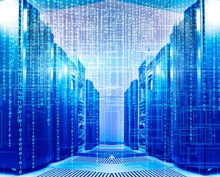 binary code covers a portion of the mainframe in data center Stock Photo