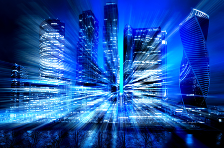 Abstract cityscape traffic background with motion blur, art toning. Moving through modern city street with illuminated skyscrapers Standard-Bild