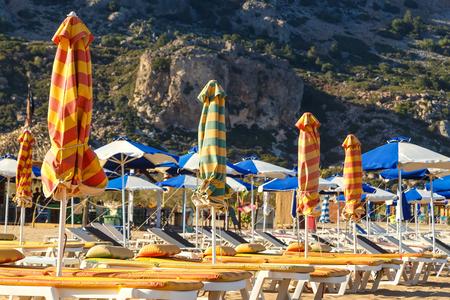 tsampika: tsampika beach with umbrellas and sunbeds. Rhodes, Greece