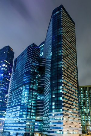 residential construction: perspective view to glass high-rise skyscrapers of Moscow city business center at night Stock Photo