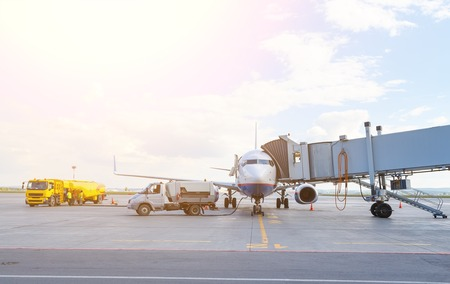 Plane stoping at airport on maintenance and refuelingand waiting for its passengers.