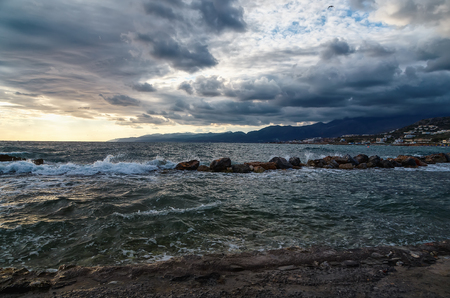 clouds with waves predshtormovoy weather on the shore of the island of Crete Greece, early morning, dawn Stock Photo