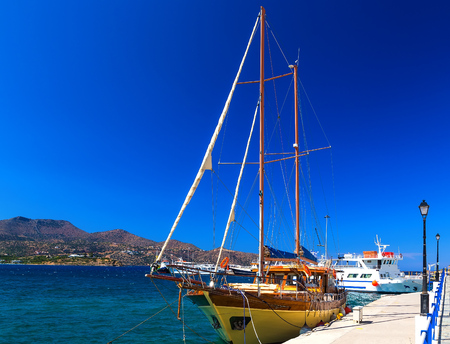 Wooden yacht in the form of an old pirate ship in the port of Agios Nikolas, Crete, Greece