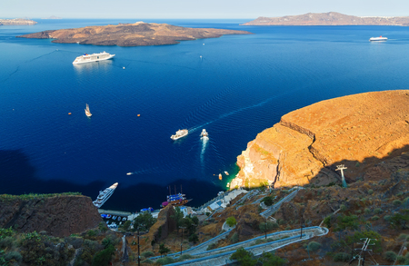 the coastline of Oia, Santorini, Cyclades, Greece. view from the hilltop and looking down to Aegean Sea