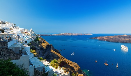 Greece. Cyclades Islands - Santorini Thira . Oia town with typical Cycladic architecture - painted blue cupolas and white walls of houses.