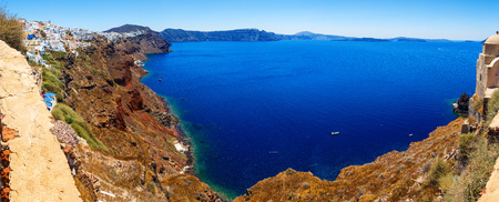 panoramic view on a bright Sunny day on the Bay and the sea cliff with height of Oia, Santorini, Greece Stock Photo