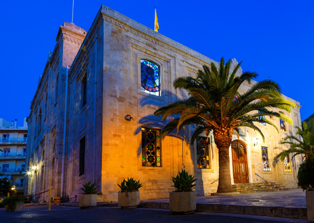 mediterranean: The Church of St Titus, or Agios Titos, in centre of Heraklion, Crete, at night with an almost full moon above it. Stock Photo