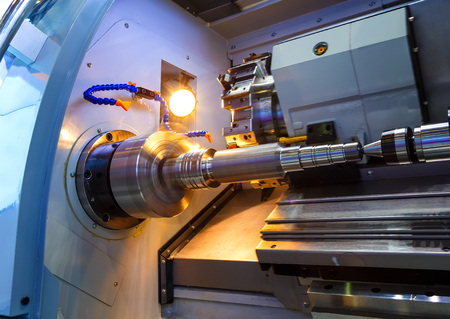 energy work: Metalworking CNC milling machine. Cutting metal modern processing technology. Small depth of field.