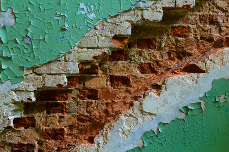 peeling paint and brick walls in place where there was a ladder , the diagonal texture of the wall with remains of brick