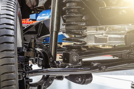 Front axle with suspension and absorber.