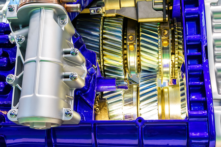 shiny car: gear inside internal combustion engine of car closeup