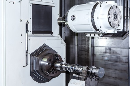 carbide: Closeup shot of machine tool in factory hall. Stock Photo