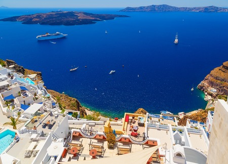 Santorini volcanic caldera as seen from Fira, capital of Santorini, Greece. Hotels with vacationing tourists