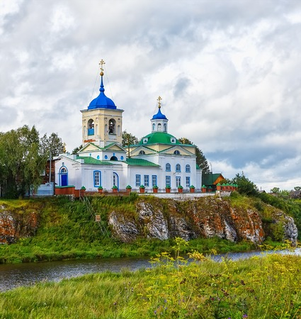 St. George Church on the rocky banks of the river Chusovaya on summer day. Russia, The Urals, village Sloboda.