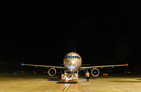 Commercial airplane at night front view, black copy-paste from above